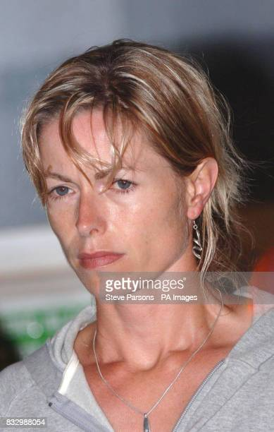 Kate McCann stands as her husband Gerry gives a statement to the press in the Algarve village of Praia Da Luz where their daughter threeyearold...