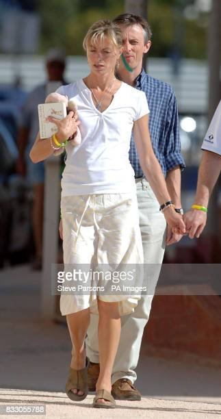 Kate McCann walks to the church in Praia Da Luz Portugal carrying a childrens soft toy and book titled 'We're Going on a Bear Hunt' Madeleine McCann...
