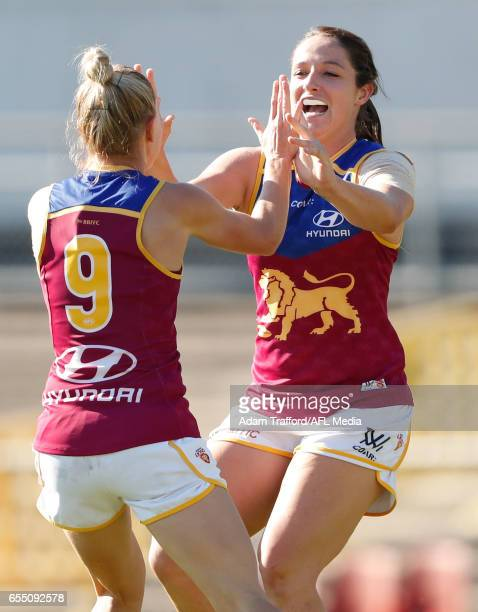 Kate McCarthy of the Lions celebrates a goal with Jordan Membrey of the Lions during the 2017 AFLW Round 07 match between the Carlton Blues and the...
