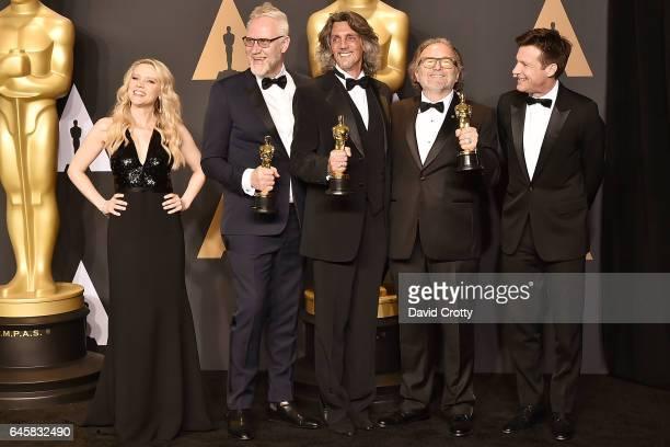 Kate McKinnon Christopher Nelson Giorgio Gregorini Alessandro Bertolazzi and Jason Bateman attend the 89th Annual Academy Awards Press Room at...