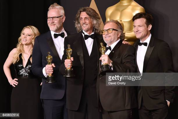 Kate McKinnon Christopher Nelson Giorgio Gregorini Alessandro Bertolazzi and Jason Bateman attend the 89th Annual Academy Awards Press Room at...