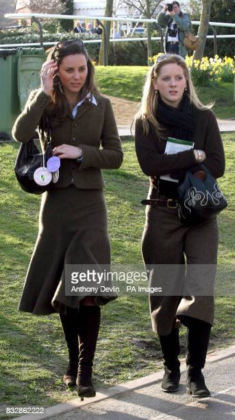 Kate Middleton and an unidetified woman are seen near the winners enclosure at Cheltenham Racecourse on the first day of the Cheltenham Festival