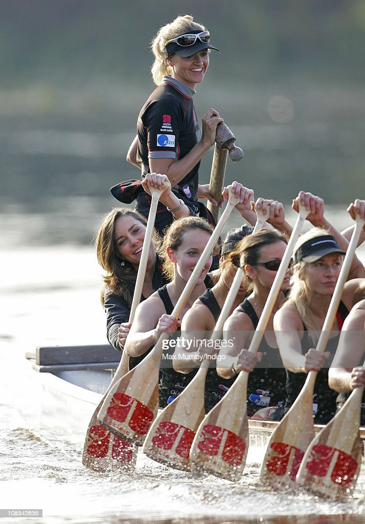 Kate Middleton (sitting bottom left) and Emma Sayle (standing) take part in a training session with the Sisterhood cross Channel rowing team, on the River Thames on August 01, 2007 in London, England.