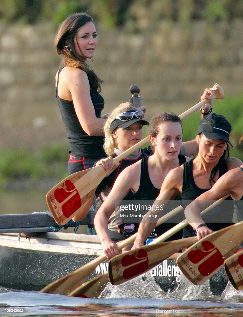 Kate Middleton (standing) and Emma Sayle (sitting bottom left) take part in a training session with the Sisterhood cross Channel rowing team, on the River Thames on August 01, 2007 in London, England.