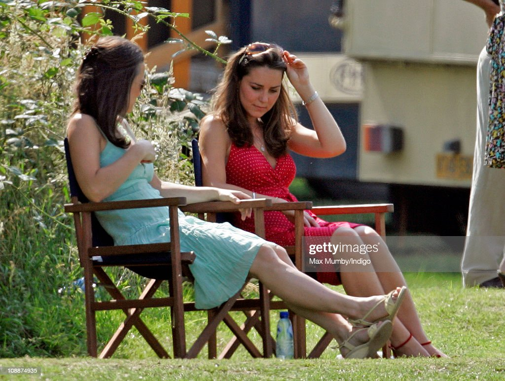 Kate Middleton and her sister Pippa Middleton watch Prince William compete in the Chakravarty Cup charity polo match at Ham Polo Club on June 17, 2006 in Richmond, England.