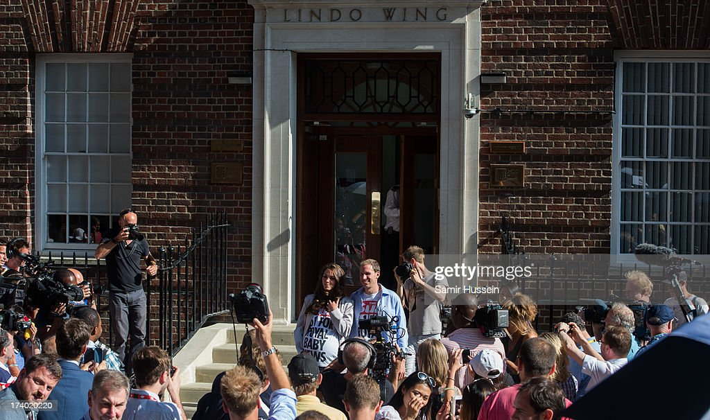 Kate Middleton and Prince William look-alikes pose for the media outside the Lindo Wing, St Marys Hospital as the UK prepares for the birth of the first child of The Duke and Duchess of Cambridge at St Mary's Hospital on July 19, 2013 in London, England.