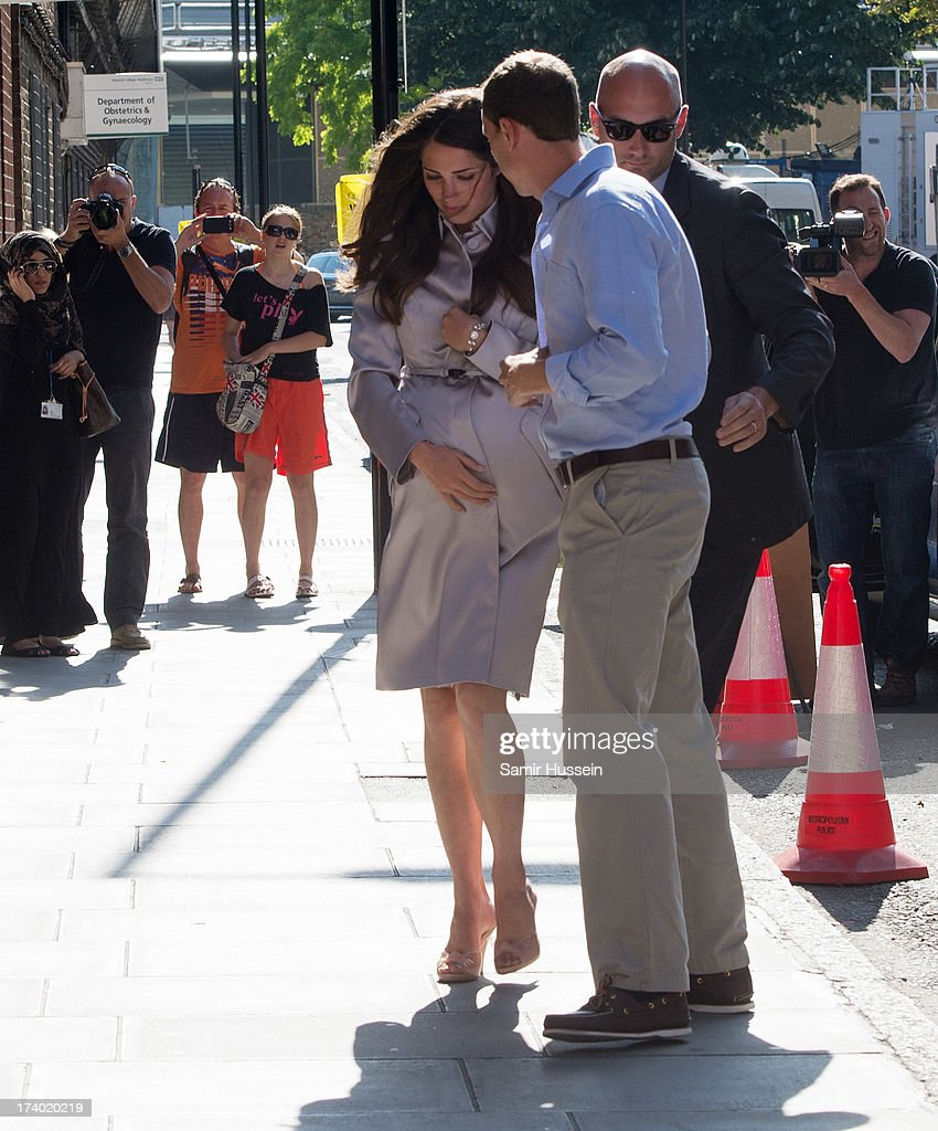 Kate Middleton and Prince William look-alikes pretend to enter the Lindo Wing, St Marys Hospital as the UK prepares for the birth of the first child of The Duke and Duchess of Cambridge at St Mary's Hospital on July 19, 2013 in London, England.