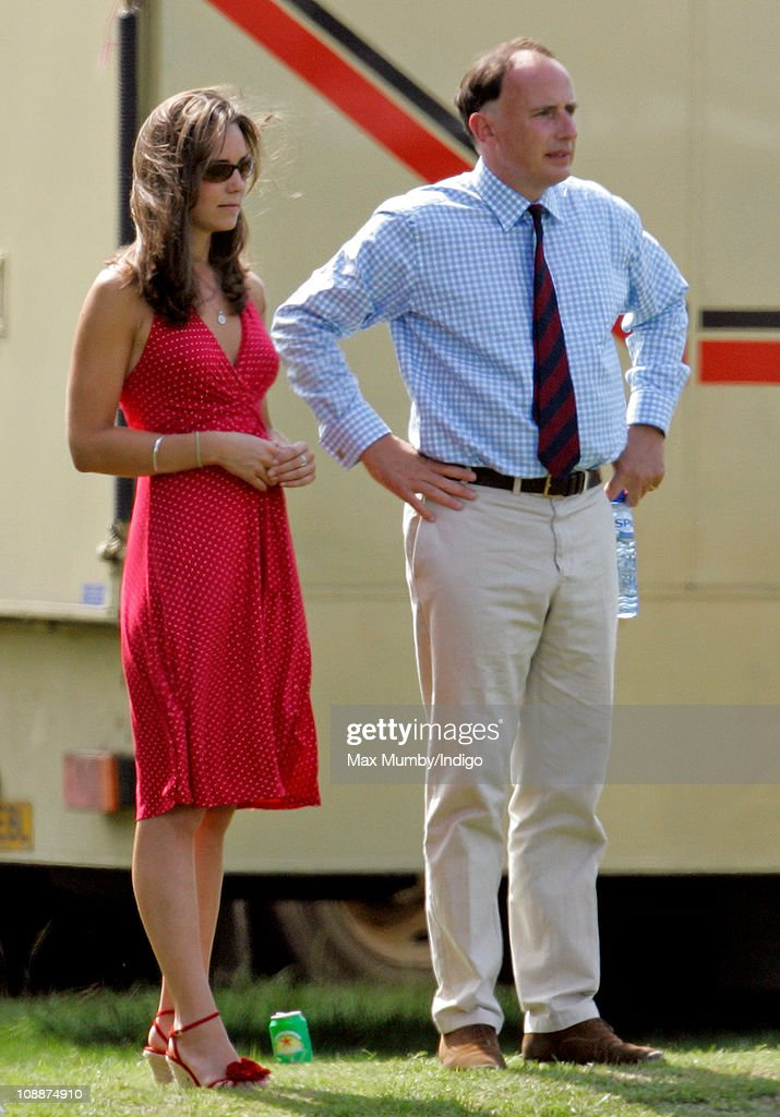 Kate Middleton and Prince William's Private Secretary Jamie Lowther-Pinkerton watch Prince William compete in the Chakravarty Cup charity polo match at Ham Polo Club on June 17, 2006 in Richmond, England.