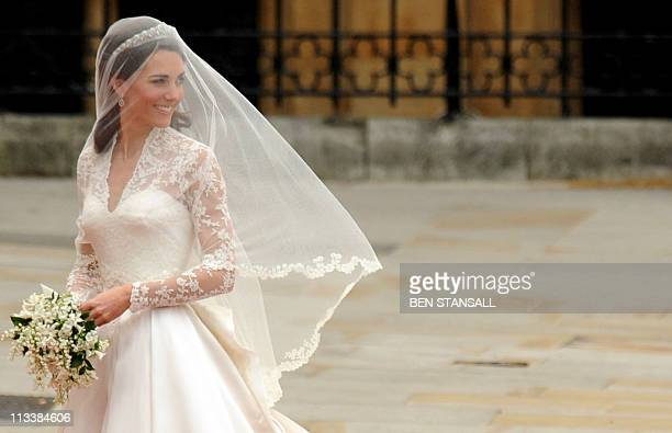 Kate Middleton arrives at the West Door of Westminster Abbey in London for her wedding to Britain's Prince William on April 29 2011 AFP PHOTO / BEN...