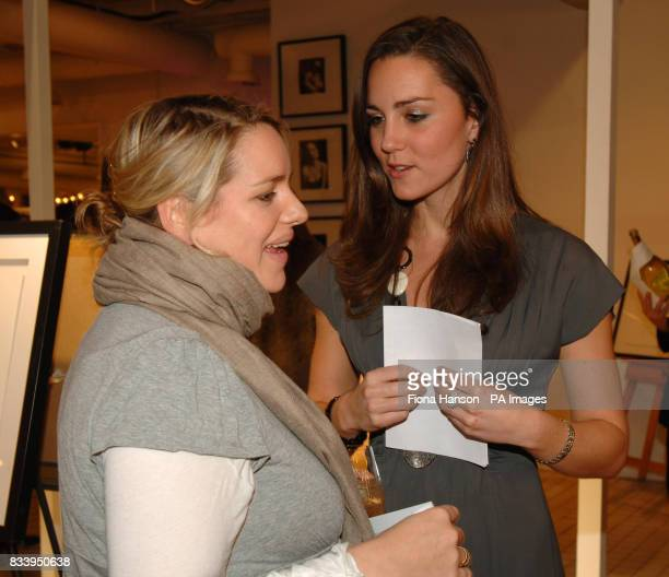 Kate Middleton girlfriend of Prince William chatting to Laura Lopes daughter of the Duchess of Cornwall while she was hosting an exhibition of...