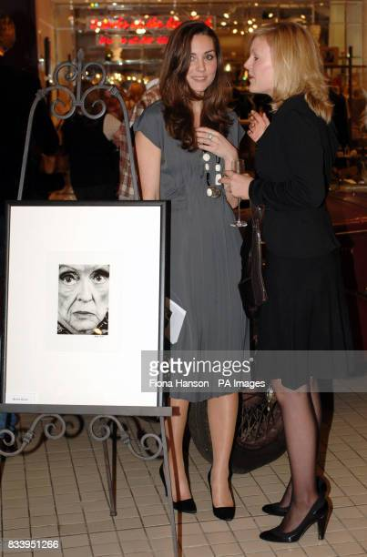 Kate Middleton left girlfriend of Prince William right hosting Time To Reflect an exhibition of limited edition photgraphs of celebrities by Alistair...