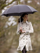 Kate Middleton shelters under an umbrella during a visit to the College of Agriculture Food Rural Enterprise CAFRE on March 8 2011 in Belfast...