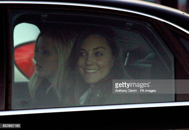 Kate Middleton sits in the back seat as Prince William drives through traffic waiting to exit the Cheltenham Racecourse after the first day of the...
