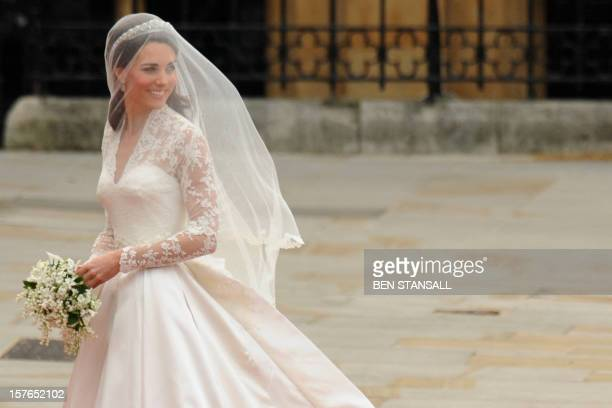 Kate Middleton smiles as she arrives at the West Door of Westminster Abbey in London for her wedding to Britain's Prince William on April 29 2011 AFP...