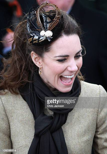 Kate Middleton smiles as she visits Trearddur Bay Lifeboat Station at Anglesey with her fiance Prince William on February 24 2011 in Trearddur Wales...