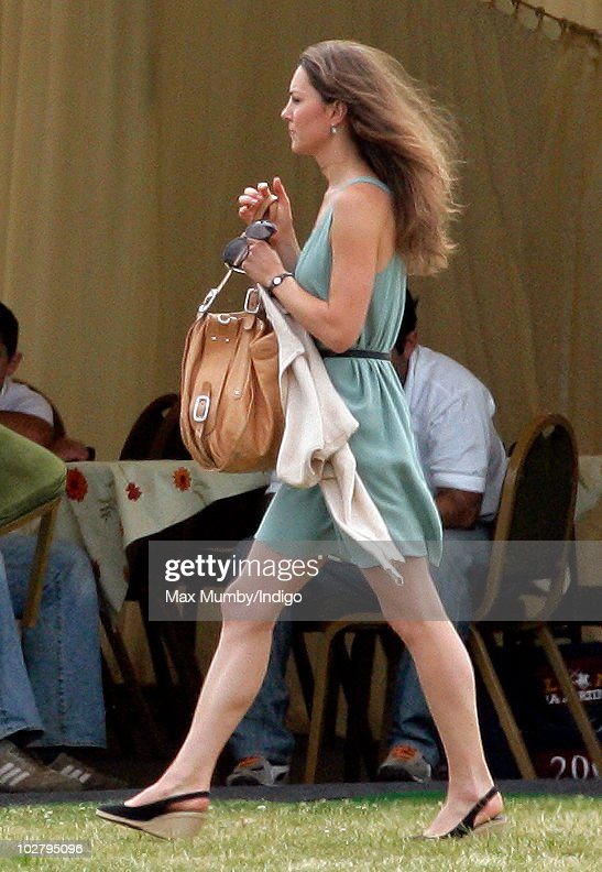 Kate Middleton watches Prince William and Prince Harry play in the Chakravarty Cup polo match at the Beaufort Polo Club on July 10, 2010 in Tetbury, England.