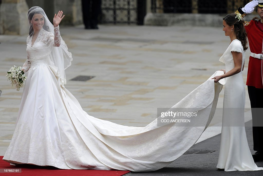 Kate Middleton waves as she arrives at the West Door of Westminster Abbey in London for her wedding to Britain's Prince William, on April 29, 2011.