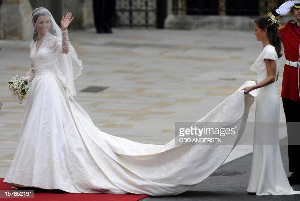 Kate Middleton waves as she arrives at the West Door of Westminster Abbey in London for her wedding to Britain's Prince William on April 29 2011 AFP...