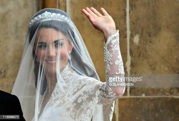 Kate Middleton waves as she arrives to the West Door of Westminster Abbey in London for her wedding to Britain's Prince William on April 29 2011 AFP...