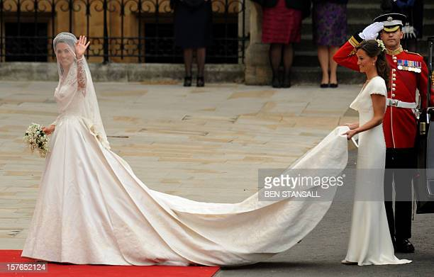 Kate Middleton waves as she arrives with her sister the Maid of Honour Philippa Middleton at the West Door of Westminster Abbey in London for her...