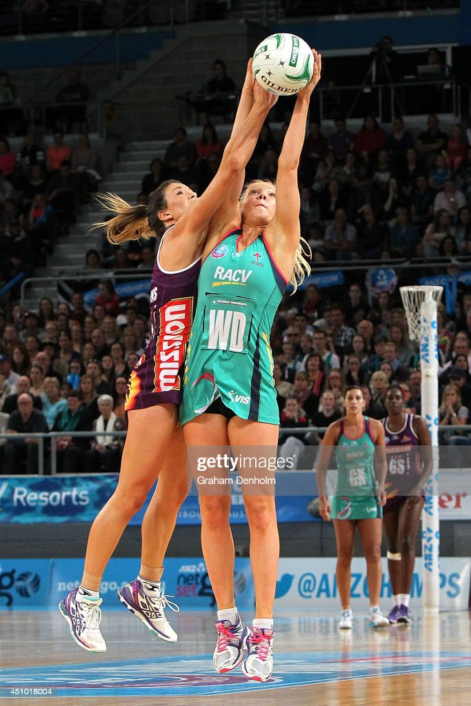 Kate Moloney of the Vixens makes a catch under pressure from the Firebirds defence during the ANZ Championship Grand Final match between the Vixens...