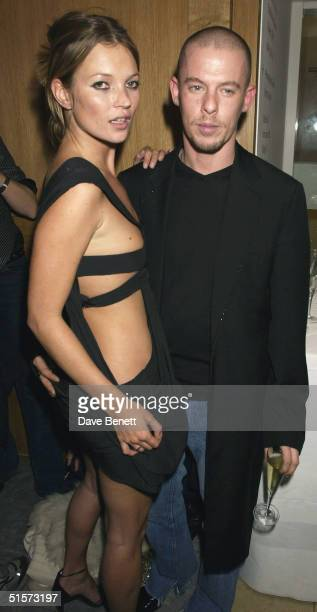 Kate Moss and Alexander McQueen attend the Mario Testino Exhibition at The National Portrait Gallery on January 30 2002 in London