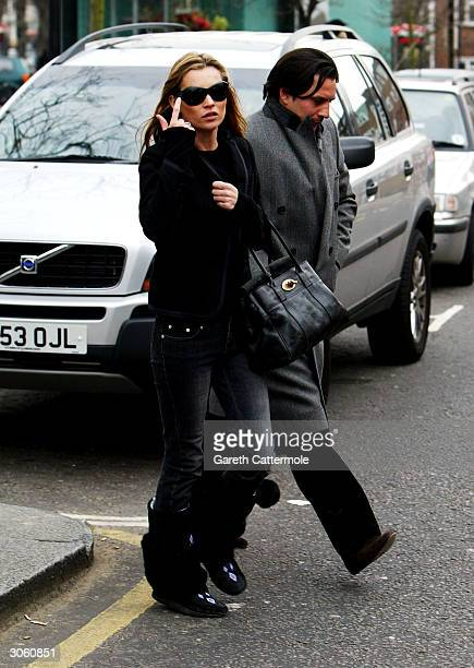 Kate Moss and an unidentified friend are seen in Notting Hill before going for lunch at Zucca March 10 2004 in London