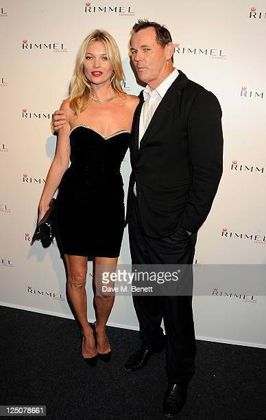 Kate Moss and CEO of COTY Inc Bernd Beetz attend the Rimmel Kate Moss Party to celebrate their 10 year partnership at Battersea Power station on...