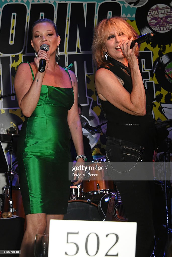 Kate Moss (L) and Chrissie Hynde perform 'Stand By Your Man' at 'Hoping's Greatest Hits', the 10th anniversary of The Hoping Foundation's fundraising event for Palestinian refugee children hosted by Bella Freud and Karma Nabulsi, at Ronnie Scott's on June 16, 2016 in London, England.