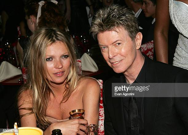 Kate Moss and David Bowie pose for a photo at the 2005 CFDA Awards dinner party at the New York Public Library June 6 2005 in New York City