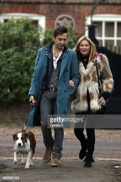 Kate Moss and husband Jamie Hince are pictured taking an early evening stroll with their dog in a London Park on February 7 2015 in London England