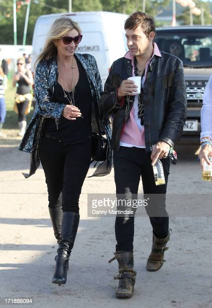 Kate Moss and Jamie Hince attend day 3 of the 2013 Glastonbury Festival at Worthy Farm on June 29 2013 in Glastonbury England