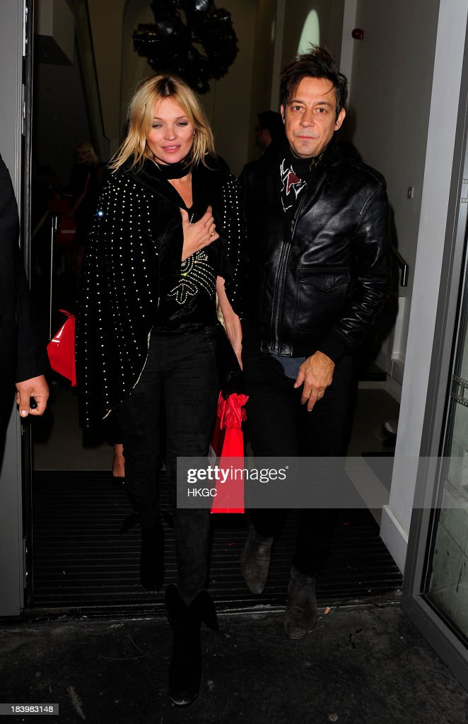 Kate Moss and Jamie Hince attend the Rimmel London 180 Years of Cool party at The London Film Museum on October 10, 2013 in London, England.