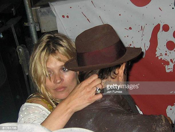 Kate Moss and Jamie Hince attend the VIP Playstation Singstar Tent on June 27 2008 in Glastonbury England Photo by Jon Furniss/WireImage