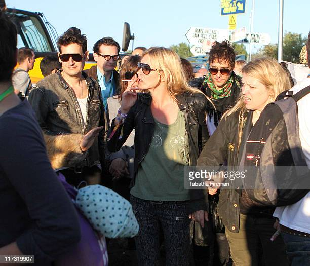 Kate Moss and Jamie Hince of The Kills get turned away from Pulp's performance as Special Guests on the Park stage during the third day of...