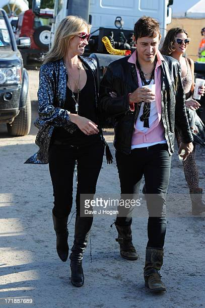 Kate Moss and Jamie Hince pose backstage at day 3 of the 2013 Glastonbury Festival at Worthy Farm on June 29 2013 in Glastonbury England