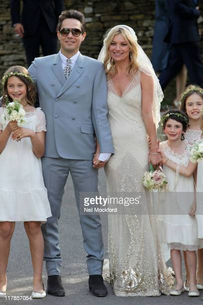 Kate Moss and Jamie Hince pose outside the church after getting married on July 1 2011 in Southrop England