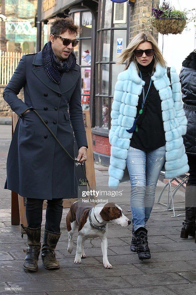 Kate Moss and Jamie Hince seen shopping and walking their dog in Highgate on December 12, 2012 in London, England.