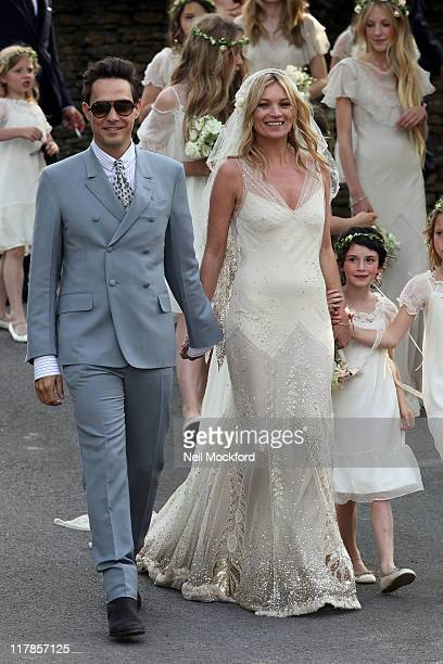 Kate Moss and Jamie Hince walk outside the church after getting married on July 1 2011 in Southrop England
