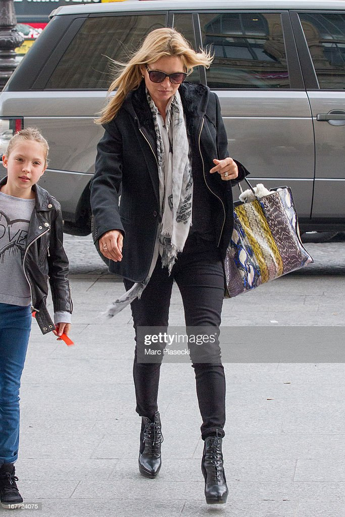 <a gi-track='captionPersonalityLinkClicked' href=/galleries/search?phrase=Kate+Moss&family=editorial&specificpeople=201830 ng-click='$event.stopPropagation()'>Kate Moss</a> and Lila Grace Moss are sighted at the 'Gare du Nord' station on April 28, 2013 in Paris, France.