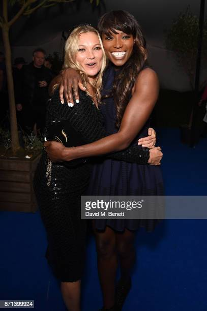 Kate Moss and Lorraine Pascale attend a dinner hosted by Jonathan Newhouse and Albert Read for Edward Enninful to celebrate the December issue of...