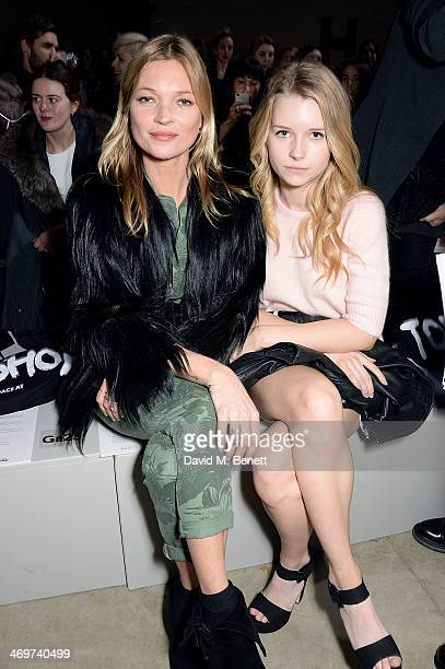 Kate Moss and Lottie Moss attend the Topshop Unique show at London Fashion Week AW14 at Tate Modern on February 16 2014 in London England