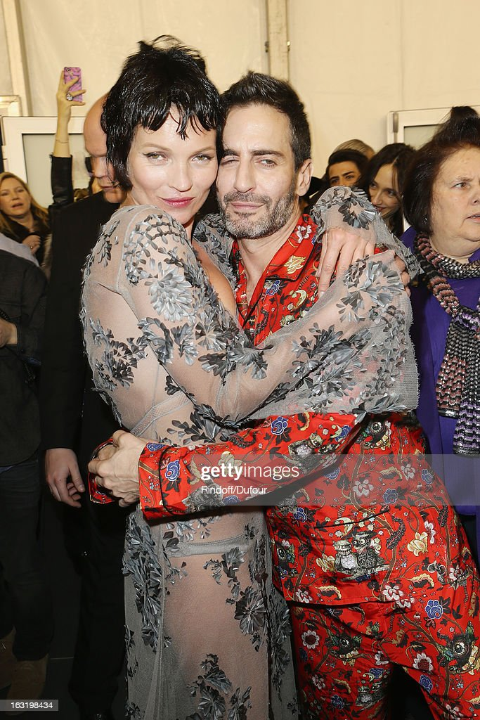 <a gi-track='captionPersonalityLinkClicked' href=/galleries/search?phrase=Kate+Moss&family=editorial&specificpeople=201830 ng-click='$event.stopPropagation()'>Kate Moss</a> (R) and Marc Jacobs share a light moment backstage following the Louis Vuitton Fall/Winter 2013 Ready-to-Wear show as part of Paris Fashion Week on March 6, 2013 in Paris, France.