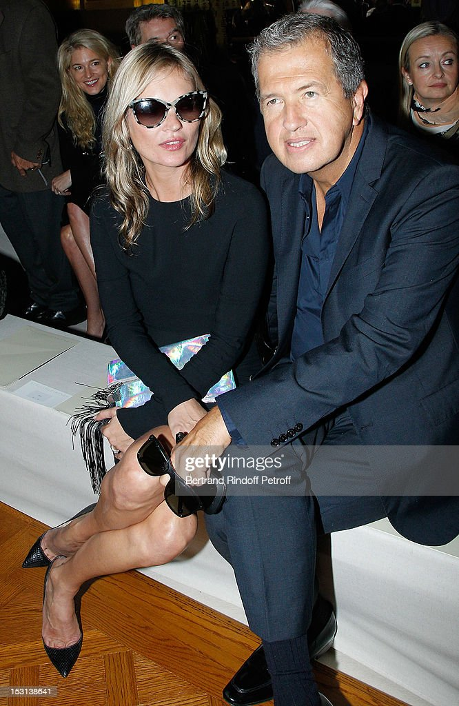 <a gi-track='captionPersonalityLinkClicked' href=/galleries/search?phrase=Kate+Moss&family=editorial&specificpeople=201830 ng-click='$event.stopPropagation()'>Kate Moss</a> and <a gi-track='captionPersonalityLinkClicked' href=/galleries/search?phrase=Mario+Testino&family=editorial&specificpeople=203087 ng-click='$event.stopPropagation()'>Mario Testino</a> attend the Stella McCartney Spring / Summer 2013 show as part of Paris Fashion Week on October 1, 2012 in Paris, France.