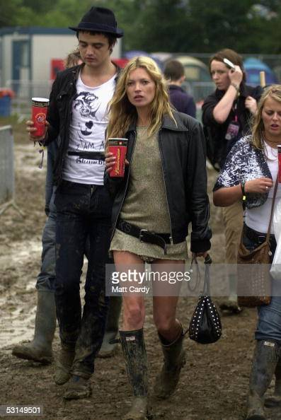 Kate Moss and Pete Doherty walk backstage on the second day of the Glastonbury Music Festival 2005 at Worthy Farm Pilton on June 25 2005 in Somerset...