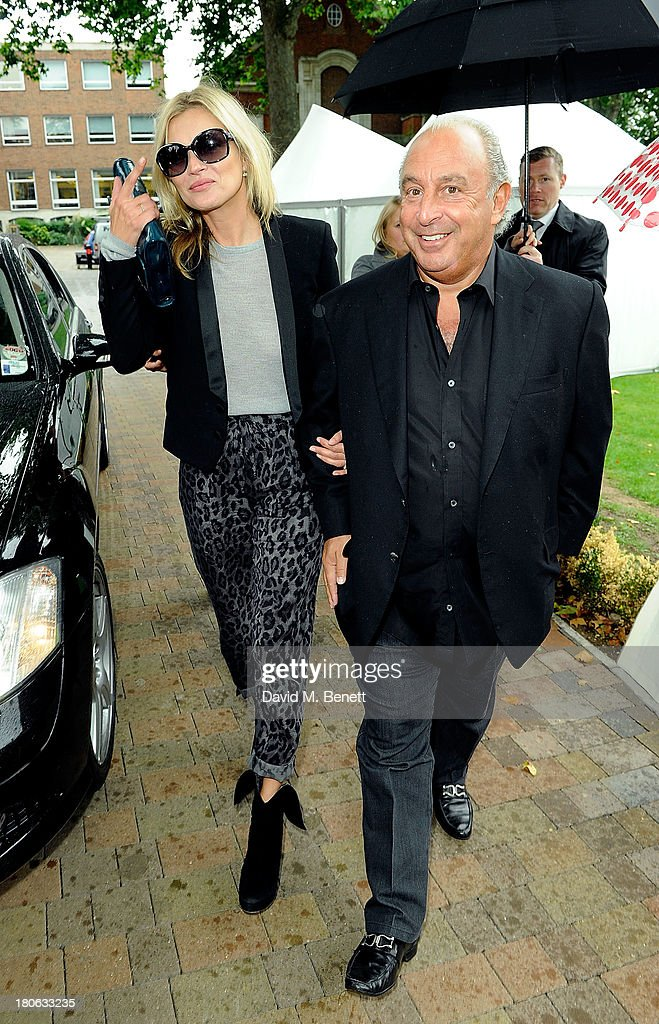 Kate Moss and Sir Phillip Green attend the Unique SS14 runway show during London Fashion Week on September 15, 2013 in London, England.