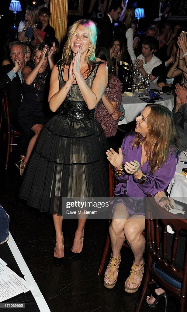 REQUIRED) <a gi-track='captionPersonalityLinkClicked' href=/galleries/search?phrase=Kate+Moss&family=editorial&specificpeople=201830 ng-click='$event.stopPropagation()'>Kate Moss</a> (L) and Stella McCartney attend the Hoping Foundation's 'Rock On' benefit evening for Palestinian refugee children at Cafe de Paris on June 20, 2013 in London, England.