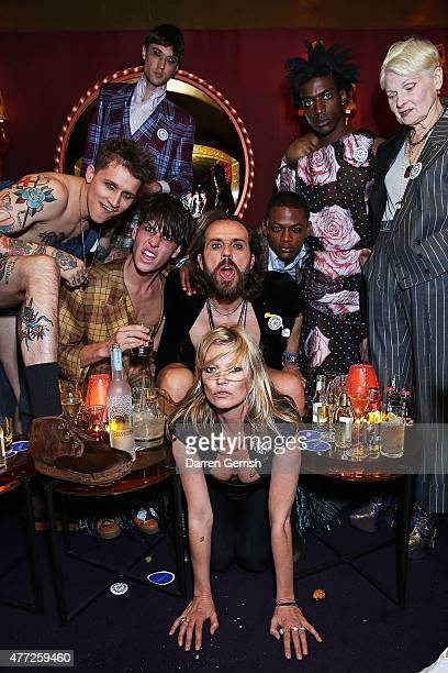 Kate Moss Andreas Kronthaler Vivienne Westwood and models attend Anotherman 10th anniversary party at Lou Lou's 5 Hertford Street Mayfair on June 15...