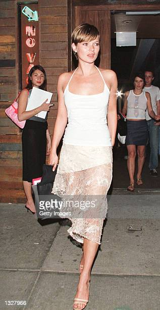 Kate Moss arrives at a party to unveil Mathew Williamson''s Fall/Winter 2001 Collection June 27 2001 at Bungalow 8 in New York City