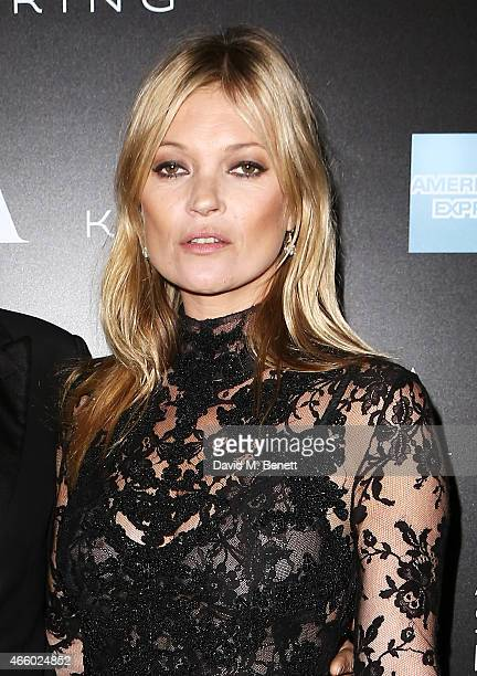 Kate Moss arrives at the Alexander McQueen Savage Beauty Fashion Gala at the VA presented by American Express and Kering on March 12 2015 in London...